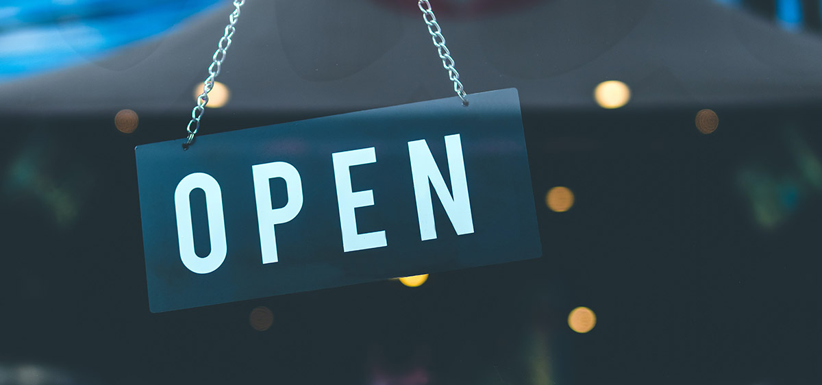 open for business sign on door